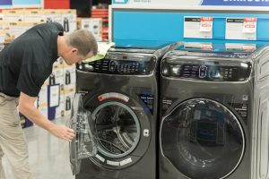 Team member with Samsung washer and dryer
